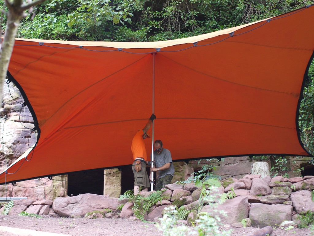 Rock house pop up cinema stretch tent over the moon tents for Tent over house